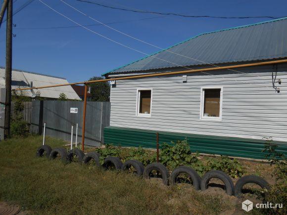 Отдельно стоящий дом на берегу водохранилища с большим земельным участком