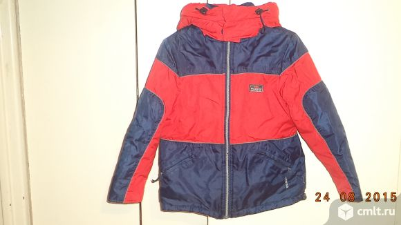 Продам тёплую куртку на 7-8 лет.