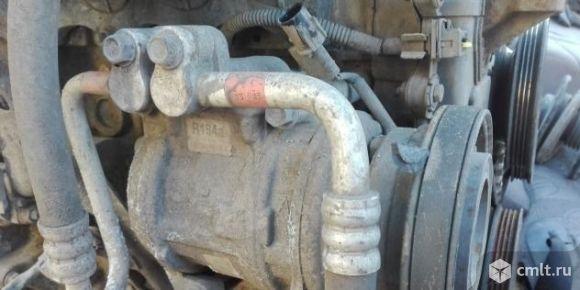 Компрессор кондиционера Hyundai Elantra XD. Фото 1.