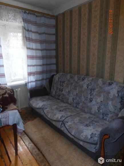 Одна комната 10 кв.м сост. хорошее очень душевные соседи,никто не прописан 2 кладовки бонус мебель. Фото 1.