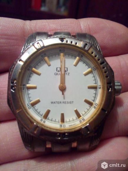 Часы фирмы q@q. Фото 1.