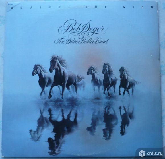 "Грампластинка (винил). Гигант [12"" LP]. Bob Seger & The Silver Bullet Band. Against The Wind. 1980.. Фото 1."