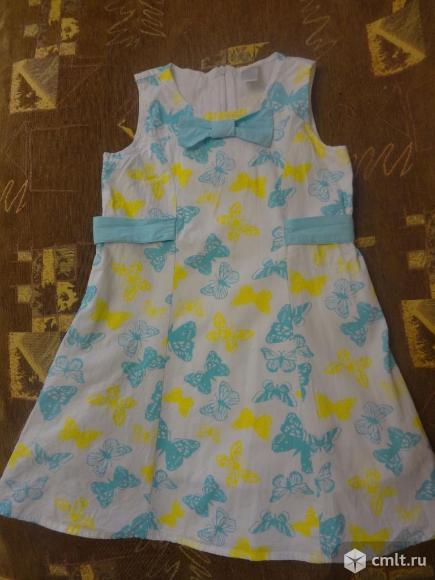 Продам нарядное платьишко для девочки в идеальном состоянии. Длина - 58 см. В подарок к нему отдам новую майку, р.122.