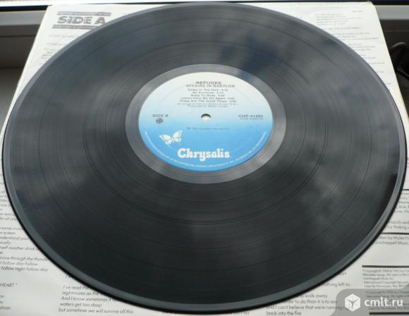 "Грампластинка (винил). Гигант [12"" LP]. Refugee. Affairs In Babylon. (C)(P) 1985 Chrysalis Records.. Фото 8."