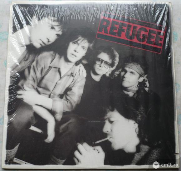 "Грампластинка (винил). Гигант [12"" LP]. Refugee. Affairs In Babylon. (C)(P) 1985 Chrysalis Records.. Фото 1."