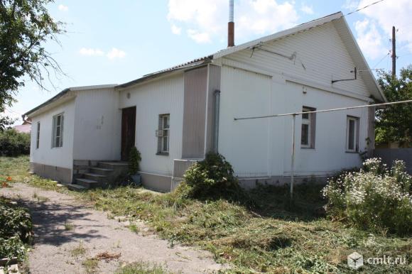 дом в Бутурлиновке ул. Ленина 34 кирпичный 125 м.кв подвал гараж 9,25 соток все коммуникации