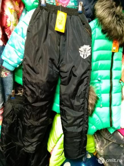Новые зимние штаны р.134-140. Фото 1.
