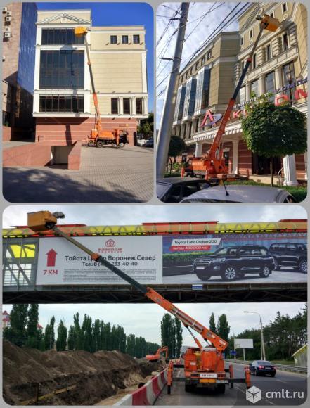 Японская автовышка в Воронеже. Мойка окон с автовышки. Фасадные работы с автовышки.