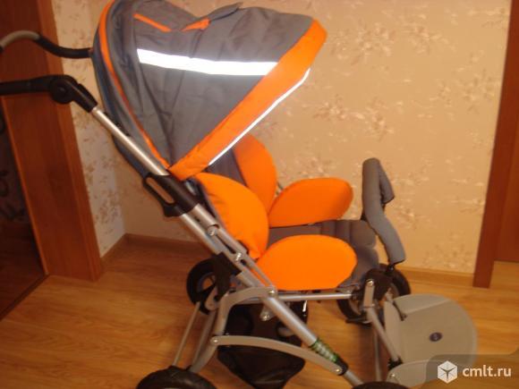 Детская реабилитационная коляска. Фото 1.