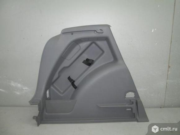 Обшивка багажника левая серая VW GOLF V PLUS 03- 5M0867427L3U6. Фото 1.