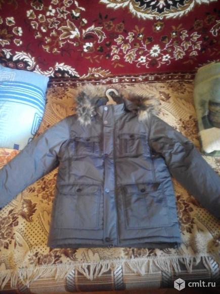 Продам новую  зимнюю куртку мужскую
