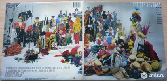 "Грампластинка (винил). Гигант [12"" LP]. Elton John. Reg Strikes Back. 1988. RTB Records. Yugoslavia.. Фото 1."