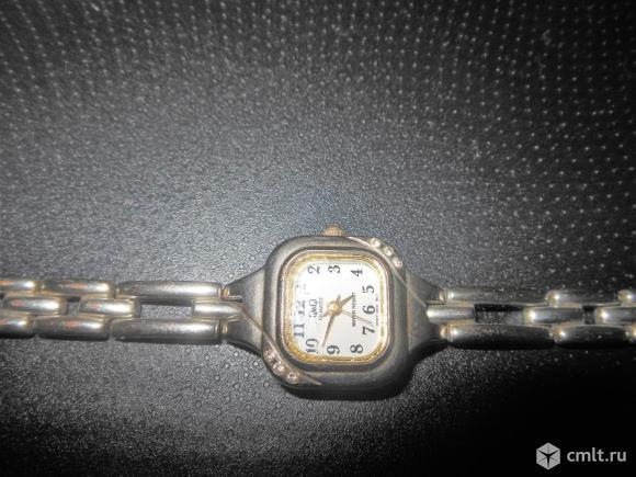 Женские часы. Фото 1.