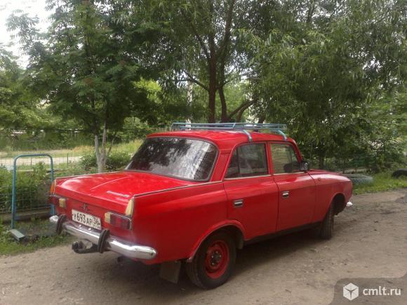 М-412 1985 г. в., 107 тыс. км, красный, фаркоп, багажник. Фото 1.