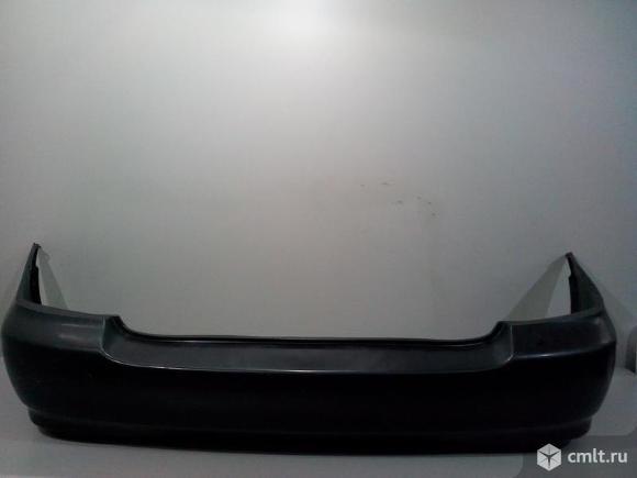 Бампер задний TOYOTA COROLLA E120 USA  CE/LE 03-08 седан 5215902911 521591A890 521590220 4*. Фото 1.