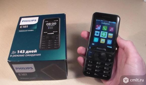 Как новый, супер АКБ Сотовый телефон Philips Xenium E181 черный. Фото 1.