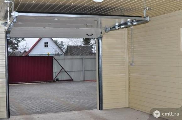 Автоматические подъемные ворота для гаража. Фото 1.