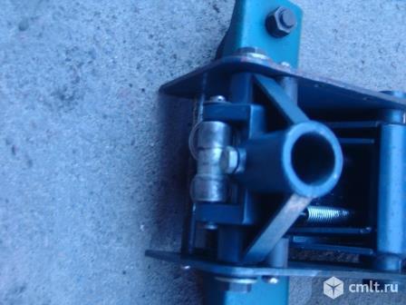 Домкрат подкатной для шиномонтажа. Фото 1.