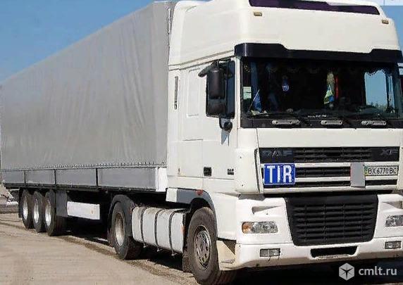 Водитель грузового автомобиля. Фото 1.