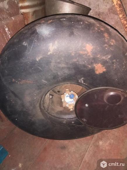 Газовый балон 42 литра   круглый вместо запаски. Фото 1.