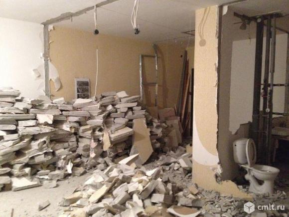 Демонтаж стен, стяжки, бетона, домов. Вырубка проемов. Фото 1.
