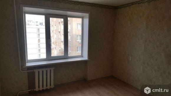 Продается комната 13.4 м2 в 9 ком.кв.. Фото 2.