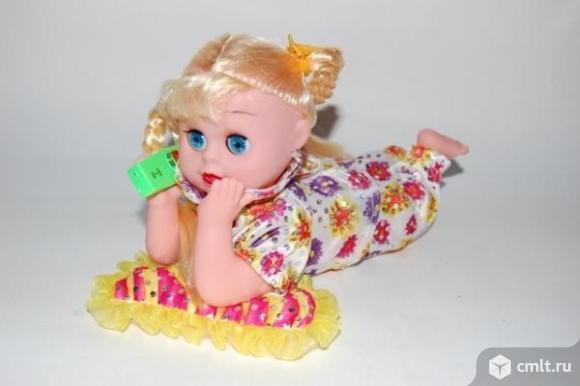 Игрушка-кукла с телефоном музыкальная озвучено на русском языке. Фото 3.