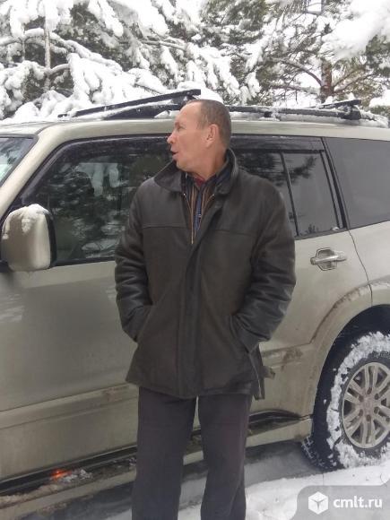 Водитель легкового автомобиля. Фото 1.