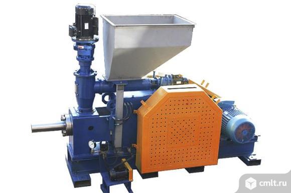 Пресс для брикетирования отходов. Фото 1.