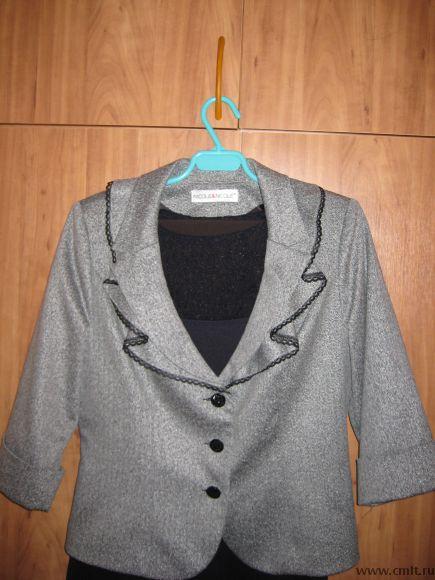 Продам женский костюм. Фото 1.