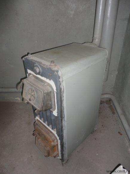 Печь чугунная с водяным контуром для отопления больших помещений на твердом топливе дизтопливе, газе